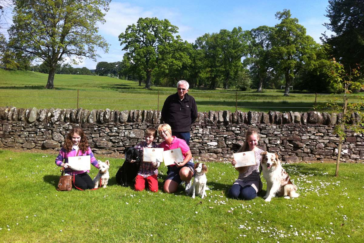 Kennel Club Good Citizen Bronze Award Successes May 2014, Ellie with Lottie, William with Meg, Jean with Truffles and Christine with Blu seen here with Jim Fleming (KCAI)